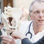 Orthopedic surgeon talking to patient