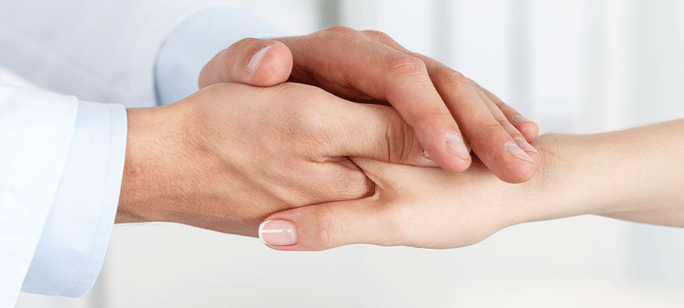 dermatologist shaking hand with patient