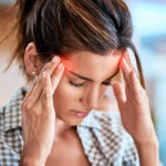 Woman with migraine pain