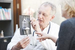 Orthopedic doctor explaining knee x-ray