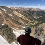 Man looks at mountains in Silverton Colorado
