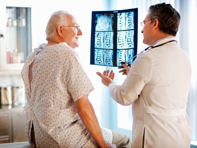 Doctor explaining xrays to patient