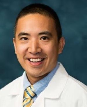 "<img src=""orthopedicsurgeon.jpg"" alt=""Dr. Eric K. Lee"" />"