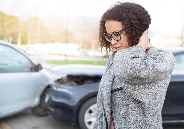 Injured woman feeling bad after having a car crash