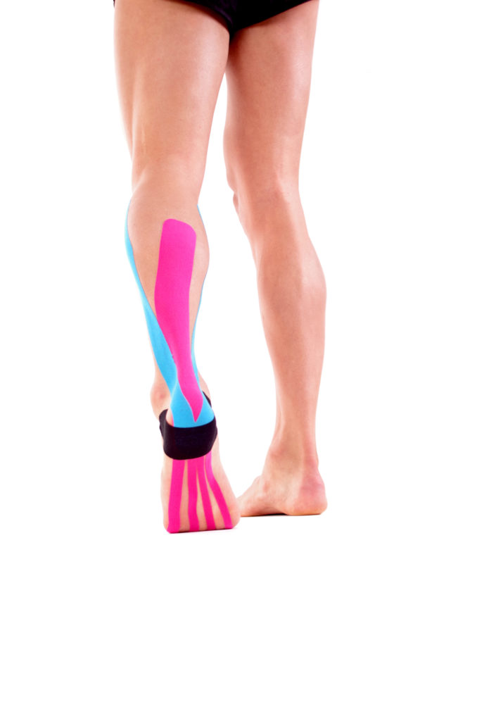 Kinesiology tape on achilles tendon. Physiotherapy for athlete