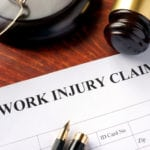 Work injury claim form on a table.