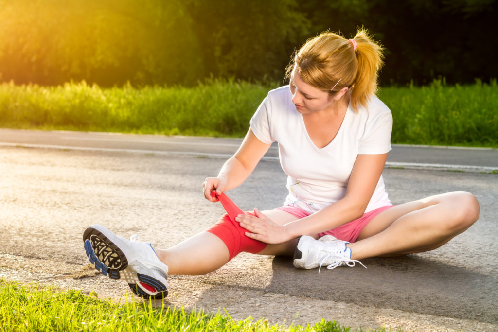 Woman treating her sports injury