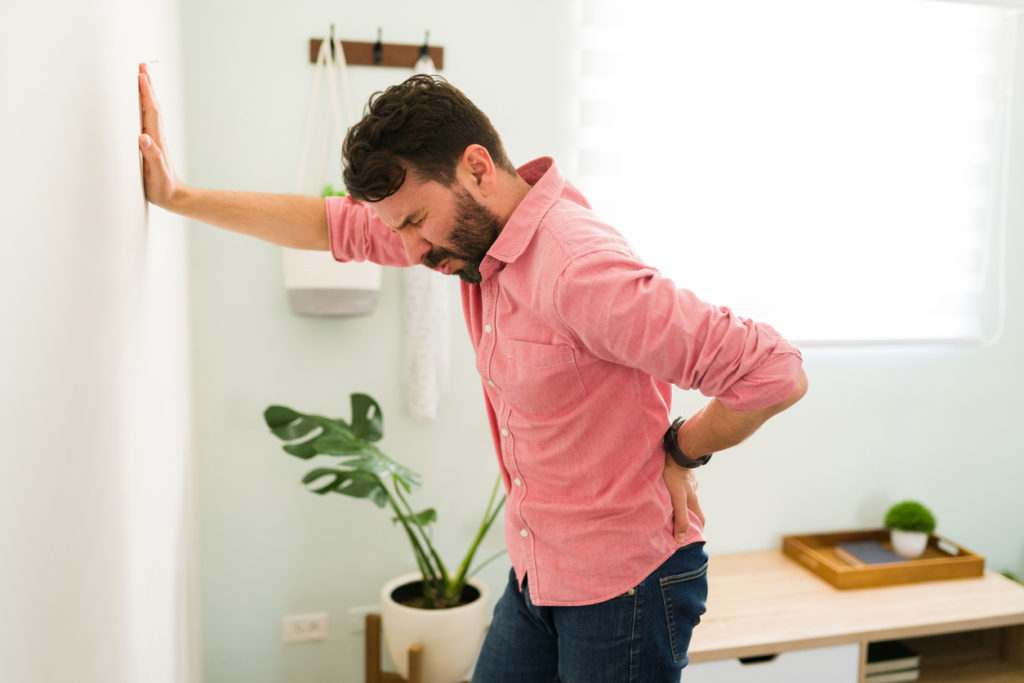 Tired young man with low back pain