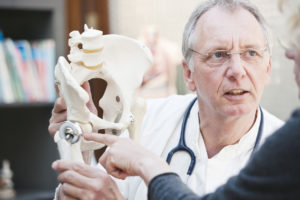 Orthopedic surgeon talking to a patient