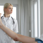 sports medicine doctor examining an ankle