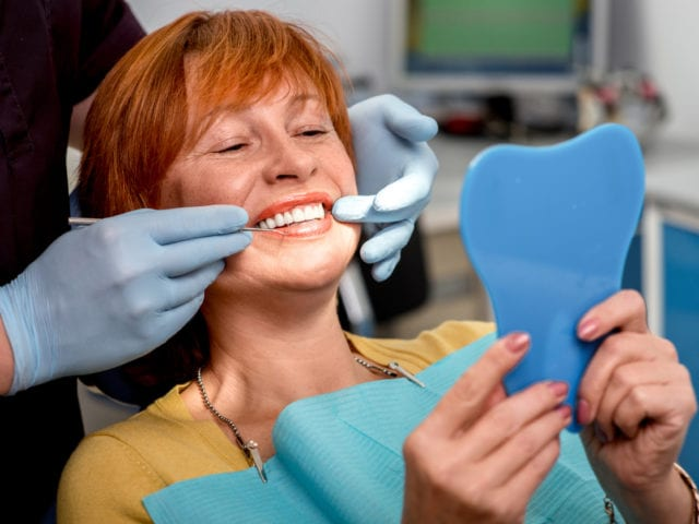 How Your Dentist Can Help You Get a Natural Smile with Dentures