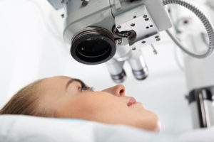 Woman getting her eye examined