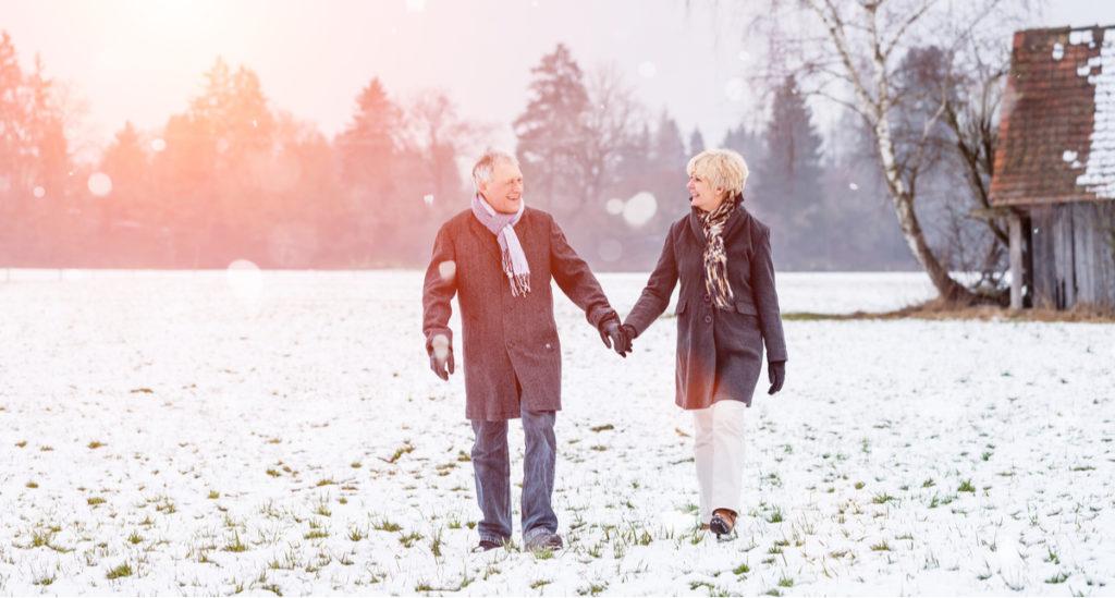 Older adults walking in snow