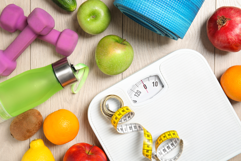 Healthy foods, exercise equipment, and a scale