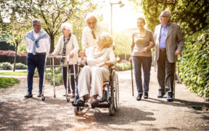Group of elderly people going for a walk