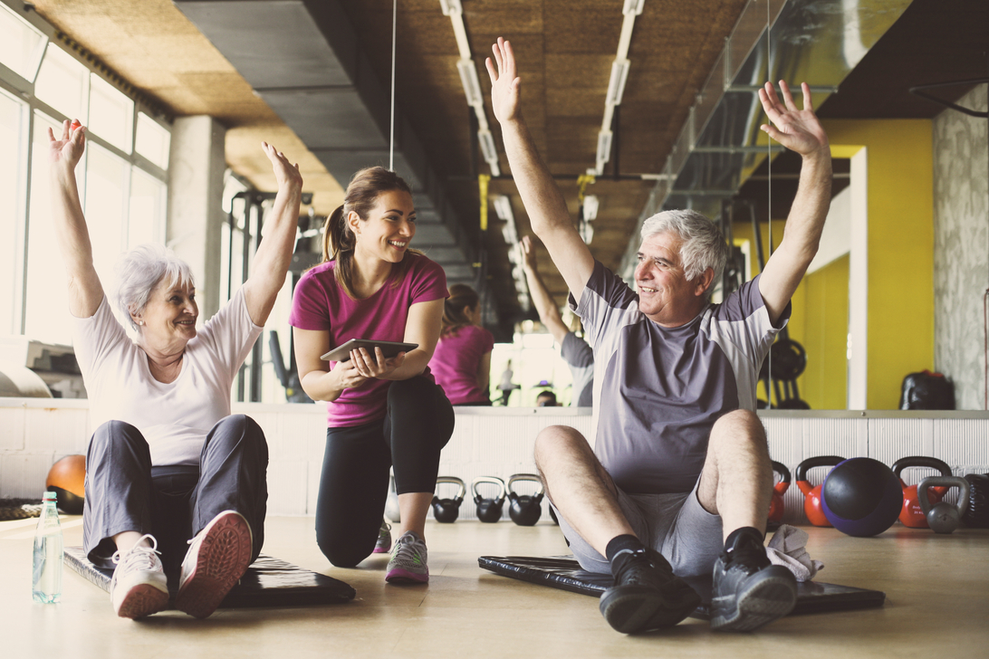 Older adults exercising with a trainer