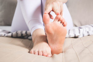 Woman with big toe joint pain