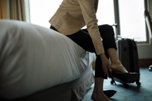 Businesswoman taking off shoes because of heel pain