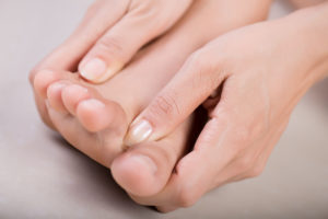 Woman with big toe pain