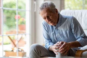 Senior man with knee replacement pain