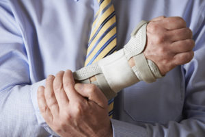 Businessman Suffering With Wrist Pain
