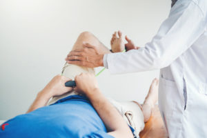 Doctor treating a patient's knee