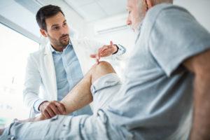 Doctor examining a patient's knee