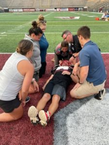 Athletic trainers in action during a training session