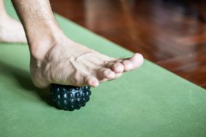 foot step on massage ball to relieve Plantar fasciitis or heel pain.