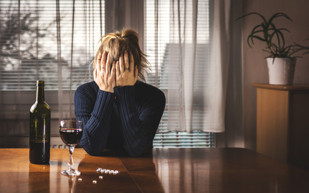 woman struggling with drug and alcohol addiction
