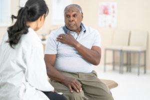 Man talking to shoulder doctor