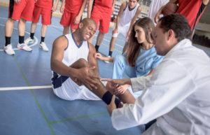 sports medicine doctor treating athlete