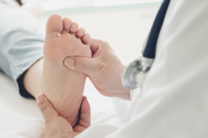 Foot doctor doing an exam