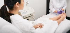 Doctor examining a woman's feet