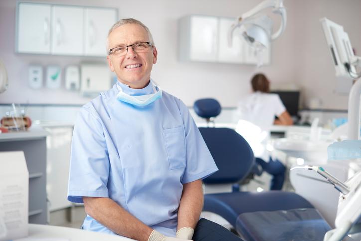 mature male dentist portrait