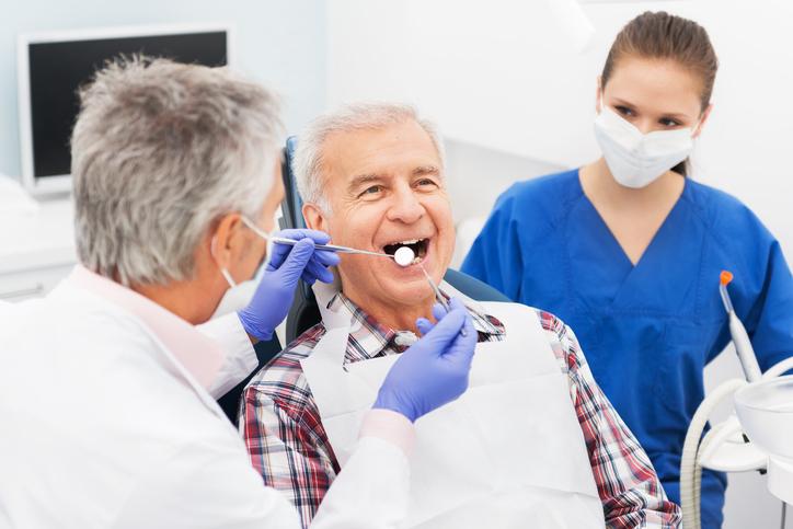 Senior Man At Dentist Office