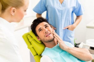 Man having toothache at dentist