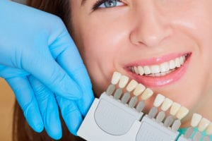 Close-up of girl with a beautiful smile dentist. Denta