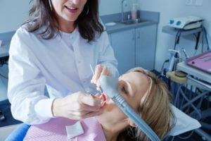 Dentist with Patient in Dental Procedure