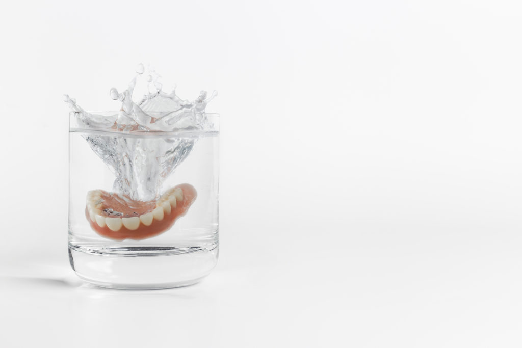 Dentures in a glass of water