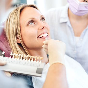 woman smiling and trying porcelain veneers