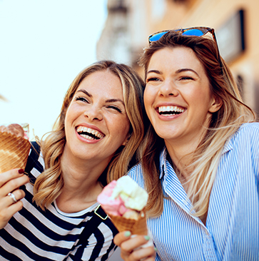 woman smiling and eating ice cream