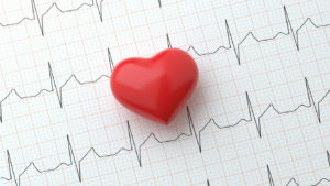 A heart on a printout of an EKG to demonstrate AFib.