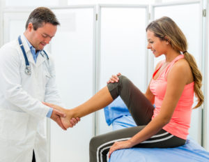 Doctor examining an ankle