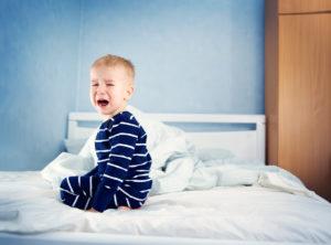 Sleepy boy in bed. Pediatric sleep apnea
