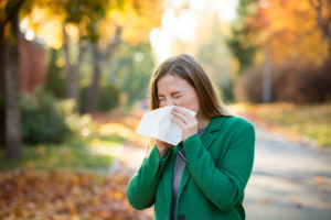 young woman suffering from allergies