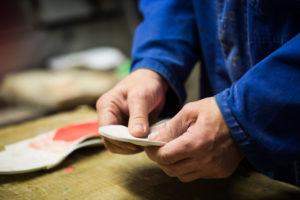 A man molding a pair of custom orthotics