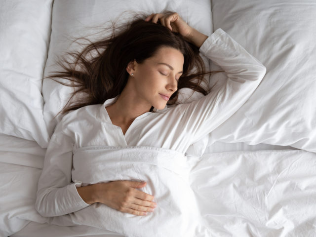 woman sleeping peacefully in her bed.