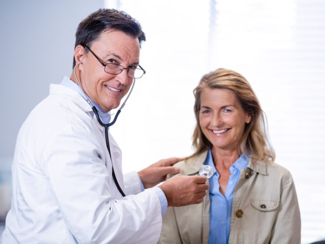 primary care doctor examining a female patient