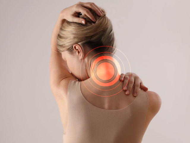 Woman suffering from neck pain.